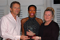 Assistant Chief Immigration Officer (Regulatory and Compliance) Ms Jeannie Lewis receives the Best Complaints Officer award from His Excellency the Governor, Mr. Duncan Taylor, CBE in the company of Complaints Commissioner Ms Nicola Williams.