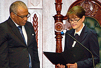 Her Excellency the Governor, Mrs. Helen Kilpatrick, CB, takes her oath of office, administered by Chief Justice Hon. Anthony Smellie, QC, at the Legislative Assembly  Friday, 6 September 2013.