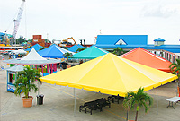 Brightly coloured tents provide a cheerful welcome to arriving cruise passengers. More importantly, they help to organise the flow of visitors who are ready to get on to island sightseeing and activities' tours.