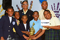 Winners all - the five primary school spelling bee winners with sponsors: L-r: Shante Reid (Goerge Town Primary), Javon Lewison (Prospect Primary), Oneika Duncan (George Town Primary), Theodore Thompson (Truth for Youth) and Jordanne Saunders (Cayman Academy); back row: l-r: Royal Bank of Canada Red Bay Branch Manager Mrs. Mitzie Bailey and RBC Area Vice President and Manager Mr. Michael Munnings