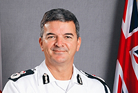 Police Commissioner David Baines gains the OBE