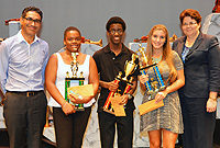 L-r: Sponsor Butterfield Bank's Mr. Michael McWatt, second place winner Chaquira Hodgson, top winner Ethan Whittaker and Elena Tacchetto, who placed third, Chief Education Officer, Mrs. Shirley Wahler