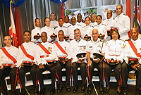 Class I of 2014 of police graduates with Commissioner David Baines, OBE, Deputy Commissioner Anthony Ennis and their tutors