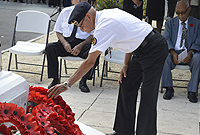 Member of Veterans Association lays wreath at Cenotaph.