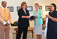 Her Excellency the Governor, Helen Kilpatrick, receives the Electoral Boundary Commission final report from Commission Chair Dr. Lisa Handley and Members, Ms Adrianne Webb (right) and Mr. A. Steve McField at Government House today (Thursday, 20 August 2015).