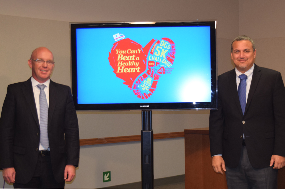 (L-R) Cayman Heart Fund Chairman David Dinner and Deputy Governor Hon. Franz Manderson unveil the 2016 Deputy Governor's 5K Challenge logo