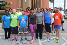 Walkers and runners gather for the launch of Off the Couch led by Miss Cayman Islands Monyque Brooks (front centre.