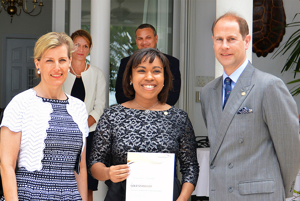 HRH The Earl of Wessex presented a certificate to this year's Duke of Edinburgh Gold Award recipient Lashonda Powell. Seen here l-r: Chair of the National Award Authority are Mrs. Kathy Jackson, The Countess, The Earl, Lashonda Powell and back row Her Excellency the Governor, Helen Kilpatrick and Deputy Governor, Hon. Franz Manderson.
