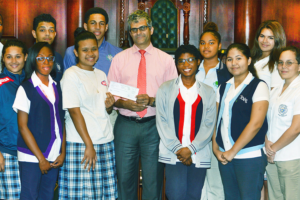 Mr. Marco Martins, Managing Partner of Harneys in the Cayman Islands presents the sponsorship cheque to the Youth Parliamentarians.