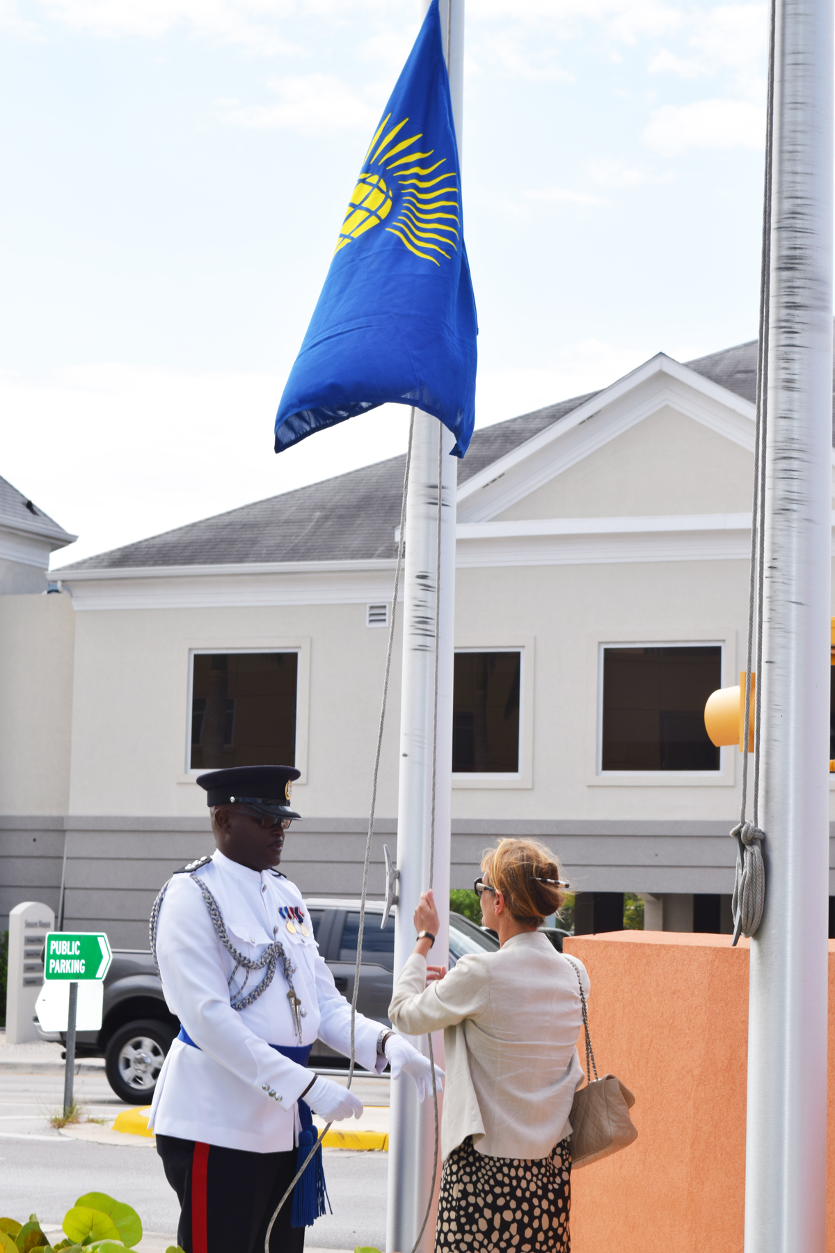 Her Excellency, Governor Helen Kilpatrick raises the Commonwealth Flag