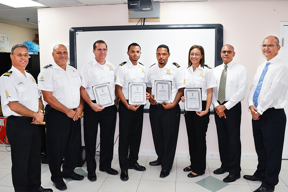 L-r: Customs Collector Charles Clifford, Training Manager Langlie Powery, graduates George Jackson, Gerome Bodden, Christopher Myles and Monique Barnett, Finance Minister Hon. Marco Archer and Financial Secretary Kenneth Jefferson