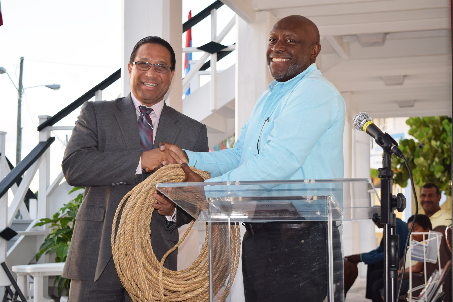 The Premier receives a coil of rope as symbolic payment for the Old Courts Building