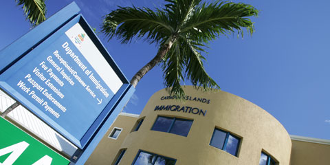 The DOI is ramping up to pursue outstanding permanent residency fees in the Cayman Islands.
