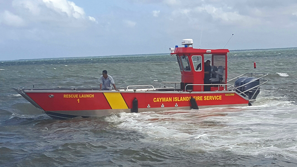 Three fire officers with the Cayman Islands Fire Service rescue 10 stranded passengers on boat.