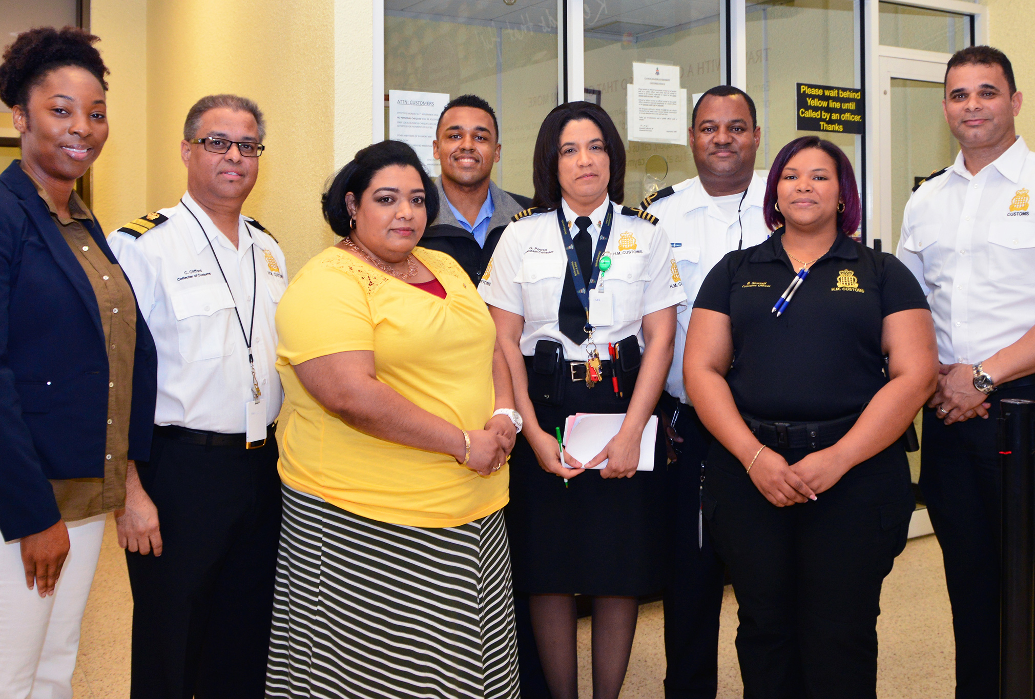 L-r: Customs' Human Resources Manager Ms Simone Mamby, Collector of Customs, Mr. Charles Clifford, member of the public Ms Caroline Roberts, Customs Porter Mr. Stephen Walton, Assistant Collector of Customs, Ms Gidget Powell, Customs Officers Mr. Barry Solomon and Ms Brandi Sherieff, and Deputy Collector of Customs, Mr. Jeff Jackson