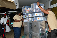 Elections staff load up vans at Elections headquarters on Smith Road to start the deployment to the 17 polling stations on Grand Cayman .
