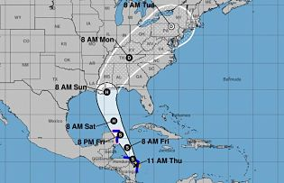 Forecast to pass hundreds of miles west of Cayman Islands