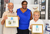 From left to right: Dr. Richard Askew, Postmaster  General, Ms Sheena Glasgow and artist of the moths stamps series, Mrs. Letitia Askew
