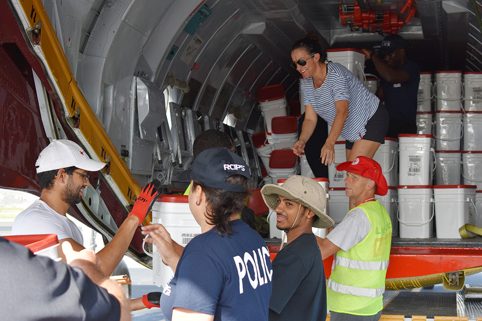 Danielle Coleman and RCIPS officers unload a Red Cross relief flight from Panama.