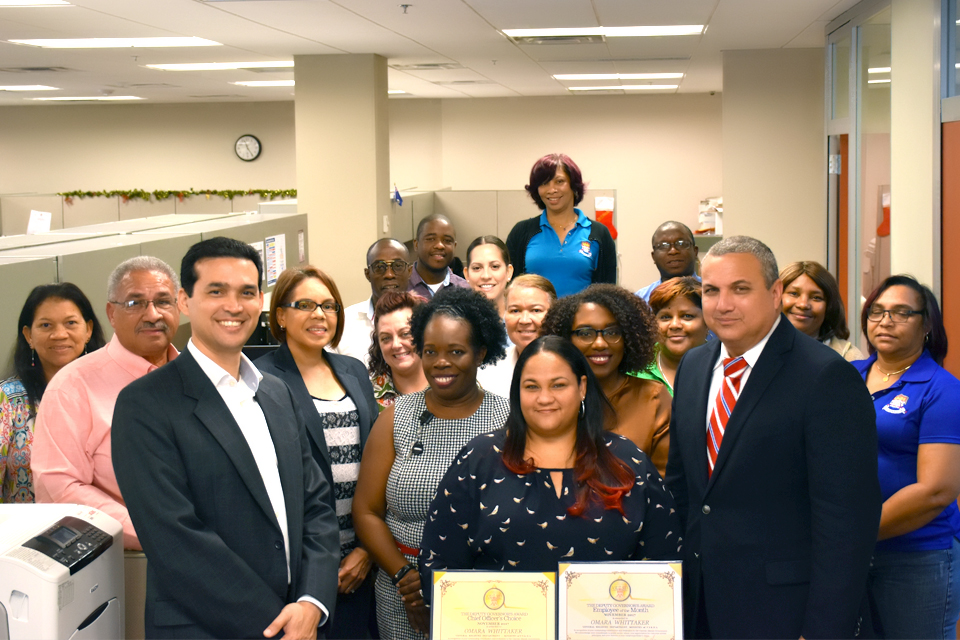 Omara Whittaker is the Cayman Islands Government Employee of the Month for November.