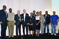 Public Works Department Director, Mr. Max Jones (fourth from left) receives the CAHRE Award on behalf of his colleagues present for running the 'Best Training Programme' in the Cayman Islands in 2017, presented annually by the Cayman Islands Society of Human Resource Professionals. See here (l-r) are: PWD Programme Manager Levi Allen), PWD Mentor Ian Gayle, Award sponsor and  Managing Director Cayman First Gordon Phillips, PWD Director Max Jones, PWD HR Manager Francene Roach, PWD Mentor Pedro Triana, Director of Education Services Lyneth Monteith, PWD Mentor Thomas Ebanks, PWD Senior Manager for Operations and Works David Johnson and PWD Mentor Allen Scott.