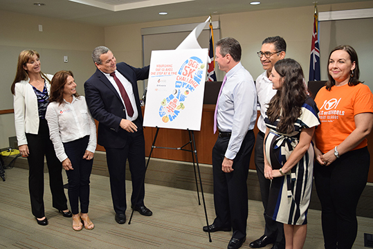 Jennifer Ahearn, Co-Chair of the DG's 5K Challenge Committee; Stacey VanDevelde, chairwoman of Feed our Future; Deputy Governor Franz Manderson; Bryan Hunter, Managing Partner of Appleby (Cayman) Ltd; Mike McWatt, managing director of Butterfield Bank (Cayman) Ltd.; Nicola Murray, president of Kiwanis Club of Grand Cayman; Erin Bodden, general manager of Cayman Islands Meals on Wheels.