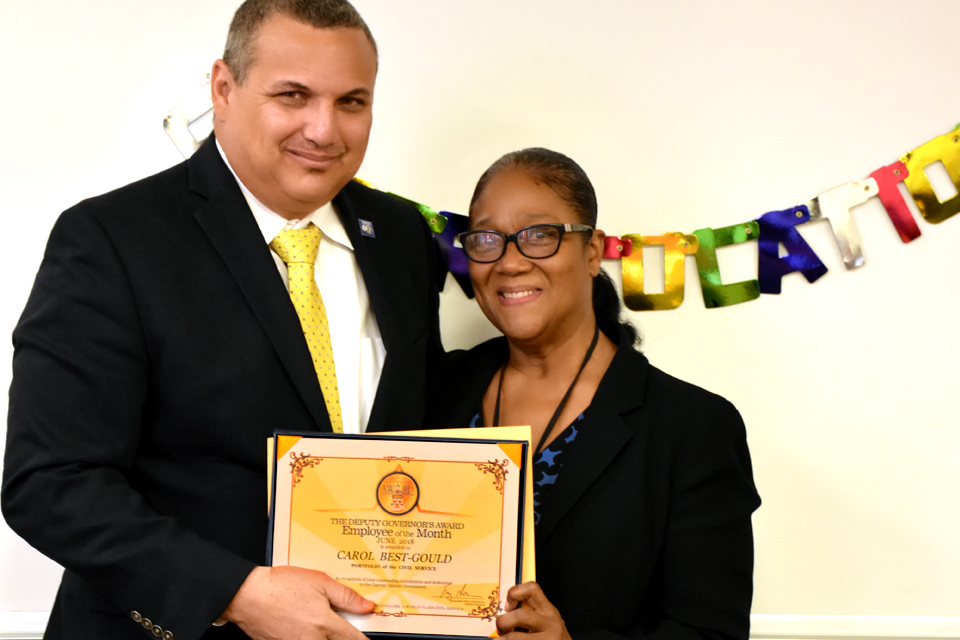 Employee of the Month Ms Best-Gould with Deputy Governor Franz Manderson