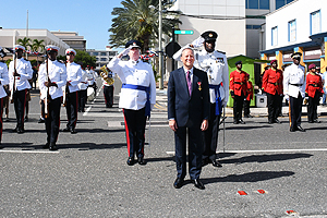 The Governor leads the parade in saluting Her Majesty the Queen.