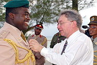 The Governor pins the Caribbean Cadet Medal on Captain Ricardo Henry.
