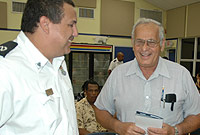 Chief Immigration Officer Franz Manderson (right) shares a light moment with businessman Hartmann DaCosta, at the recent Immigration District Evening in Savannah.