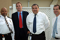 (From left) Deputy Chief Immigration Officer for Enforcement/Intelligence Dennis Brady with Stuarts, Walker, Hersant Senior Partner Chris Humphries; Chief Immigration Officer Franz Manderson; and Stuarts' Managing Director Andrew Hersant.