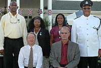 (Seated, from left) His Excellency the Governor, Mr Stuart Jack, CVO; and Deputy Chief Secretary Donovan Ebanks, MBE, with Prison Service recipients (from left) Senior Officer Michael Stephenson, Prison Officers Vernita Zuniga and Novelette Wade, and Lead Officer George McLaughlin.