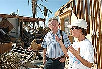 HE the Governor Mr Stuart Jack and Brac Reef's manager Kathy Shroy in the hotel ruins.