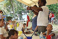 Artist Aston Ebanks interacting with kids earlier this year at the popular Sister Islands Art Camp