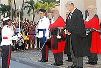Chief Inspector Angelique Howell, the first police woman to command a police honour guard, salutes the Chief Justice the Hon. Anthony Smellie, flanked by Acting Police Commissioner James Smith (front row, left) and Clerk of Courts Valdis Foldats, and accompanied by Grand Court Judges Mr Justice Alexander Henderson (back row, left) and Mr Justice Charles Quin.