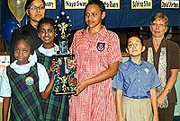 Royal Bank of Canada's Mrs Mitzi Bailey (left) and Jill Howse (right), with the four champions (from left) Nayo Swan, Anitha Velusamy, Aliyah Linwood and Laura Hynd.