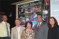 The Cayman delegation members in front of the Cayman Islands panel of the exhibition: (L-R) Ministry of Health and Human Services Deputy Chief Officer for Policy and Planning Leonard Dilbert; HE the Governor Mr Stuart Jack, CVO, Mrs. Mariko Jack, Minister of Education Hon Alden McLaughlin, Jr, JP and Freedom of Information Commissioner Jennifer Dilbert.