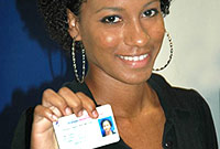 This new voter collected her registration card this week.