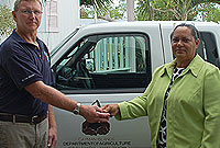 Department of Agriculture (DoA) Veterinary Officer Dr Colin Wakelin (left), receives the keys for a modified 2009 Ford Ranger from Agriculture Minister, the Hon. Juliana O'Connor-Connolly.