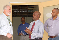 Minister of Community Affairs and Housing, the Hon. Mike Adam, MBE, JP (left) discusses West Bay Golden Age Home with PWD Project Manager Michael Payne (right). Also pictured is the ministry's Acting Chief Officer Leonard Dilbert.