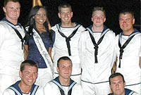 Miss Cayman Islands Nicosia Lawson with some crew members.