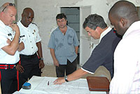Reviewing the plans are (L-R) Officer-in-Charge for Cayman Brac, Chief Inspector Malcolm Kay; Sgt Wayne Taylor; Mr. Elie Kozaily owner of KM Limited: Commissioner of Police David Baines and PWD architect Colin Lumsden.