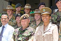 Minister of Youth the Hon. Mark Scotland (front row L) and CI Cadet Corps Acting Commandant Bobeth O'Garro (front row R) with visitors from Canada, Australia and the UK.