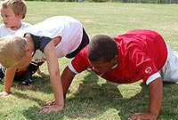 It's hard work to get fit! Here some football campers do push-ups to get in shape for the game.