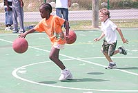 Cayman Brac children enjoying a basketball summer camp.