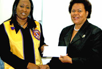 (L-R) Lions Club of Tropical Gardens President Melrose Gooding and DCFS Director Deanna Look Loy.