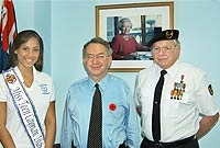 Calling on the Governor to begin this year's poppy appeal: (L-R) Miss Teen Cayman Jamesette Anglin; His Excellency the Governor, Mr. Stuart Jack, CVO; and veteran Captain Dale Banks.