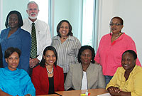 Minister for Community Affairs and Housing the Hon. Mike Adam, MBE (centre) pictured with officials and other participants at the opening of the staff development programme. Standing, right is Dr. Peta-Anne Baker.