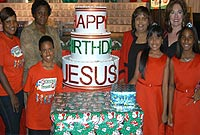 Church of God Chapel Children's Choir members donate gifts to DCFS clients. (L-R) DCFS Social Worker Sherene Barnes; DCFS Community Development Officer Zemrie Thompson; Choir Member D' Andra Monteith; Church of God Chapel Children's Choir Director Carol Mascarenhas; Musical Writer/ Director Celeste Clydesdale; Choir Members Jacie Mascarenhas and Amirah Gallow.