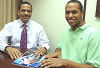 Minister of Sport the Hon. Mark Scotland meets with Shaune Fraser to discuss his future as a Cayman Elite Athlete.